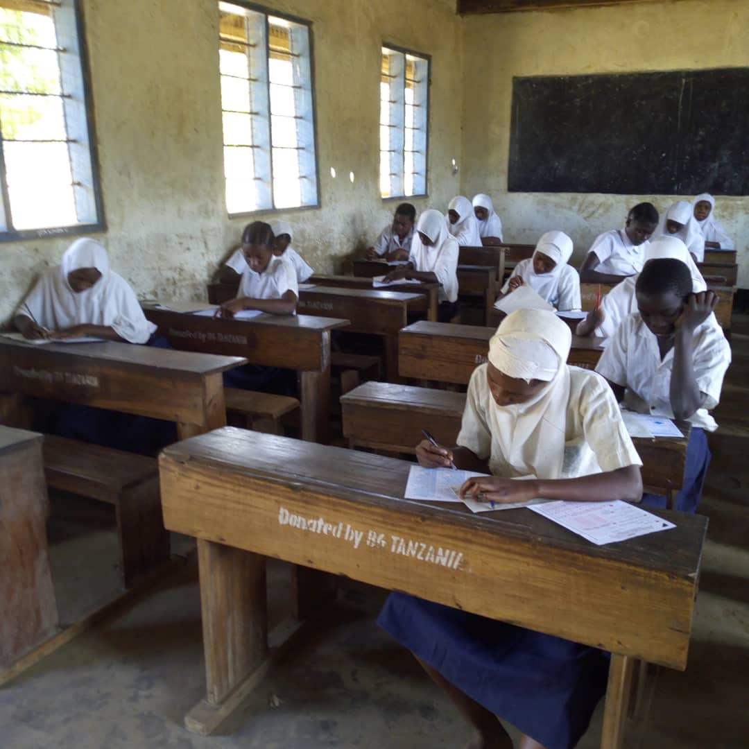 primary school children sat at desk sitting mock examination
