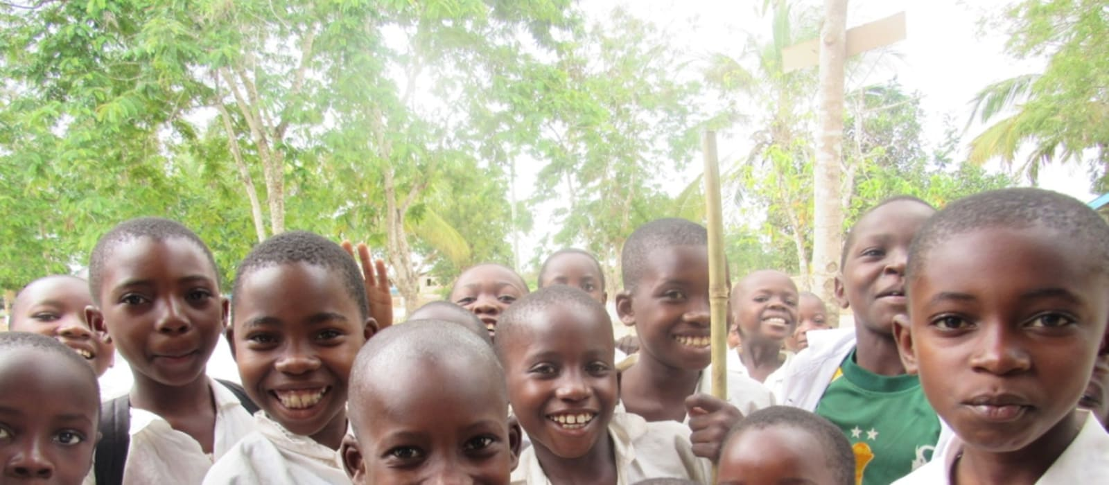 A group of children smiling in Tanzania
