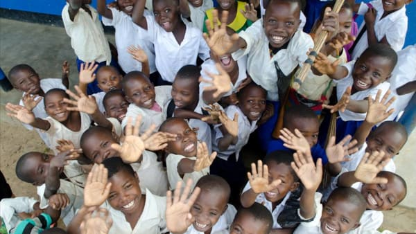 a group of children waving