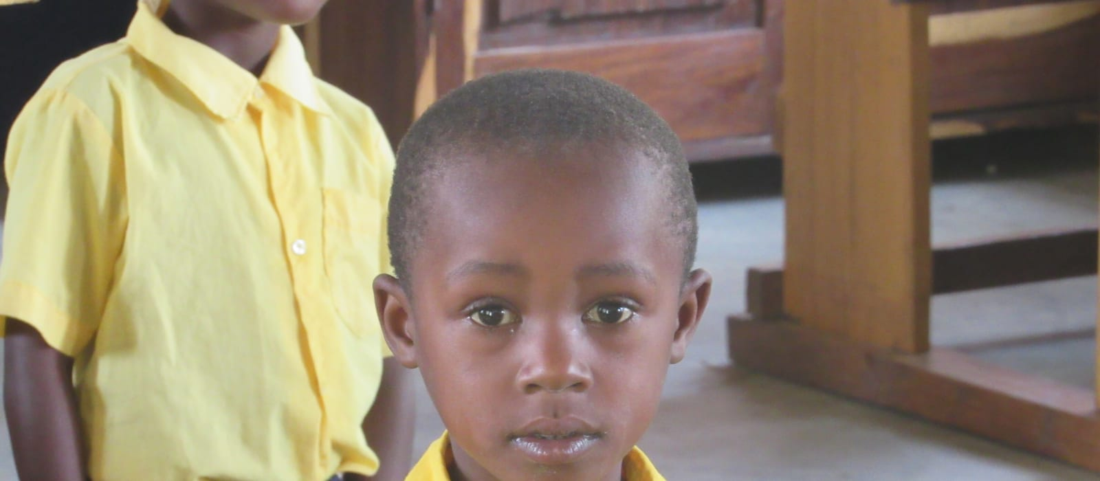 young boy in school in Tanzania